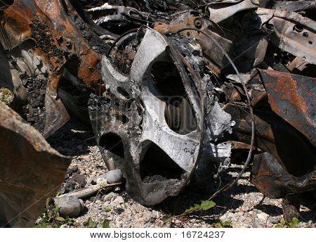 burnt car wreckage photo
