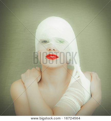 the beauty woman with red lips in bandage photo