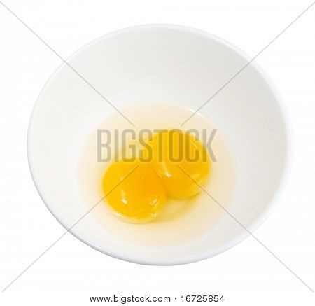 Raw eggs in a white dish (isolated).