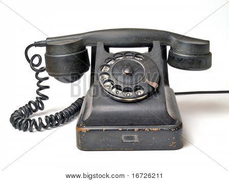 Alte Telefon legen Sie auf einem weißen Hintergrund.