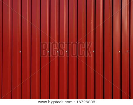 Red corrugated surface.