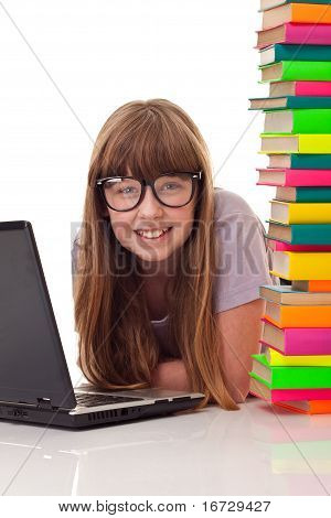 Girl On Floor With Books And Laptop