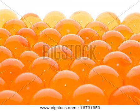 A lot of semitransparent orange balls on white background.