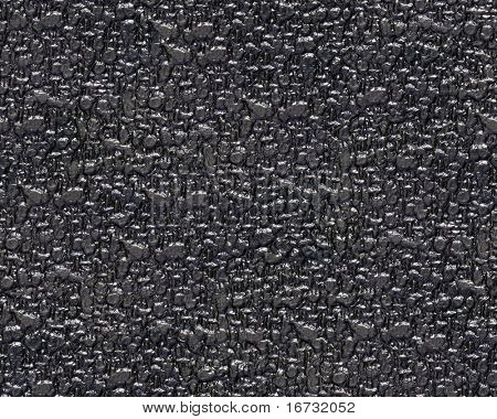 Seamless abstract black bumpy surface background.