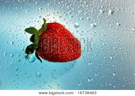 Strawberry red on a blue background