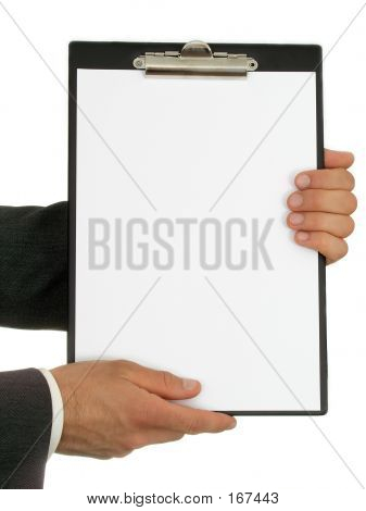 Businessman's Hands Holding Clipboard