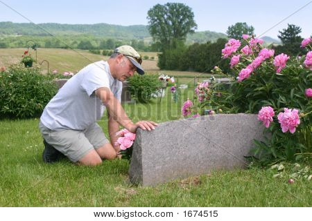 Mourning At Cemetery