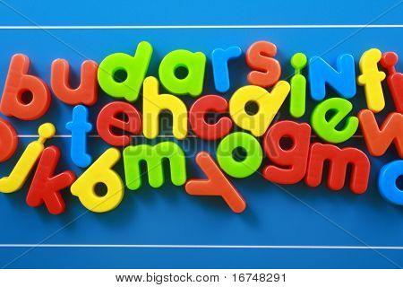 colorful letters on blue board - education concept