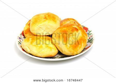 baked buns on a plate