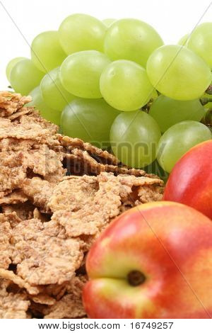 healthy snack - pile of cereals and fresh nectarines and grapes close-ups