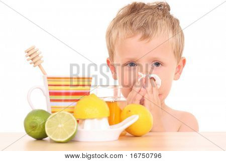 3-4 years old boy with cold and flu remedy on white /focus on kid/