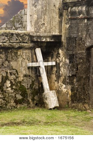 Lonely Cross Against Wall