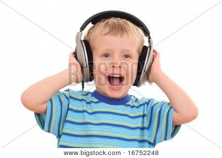 cute 3-4 years old boy listening music isolated on white