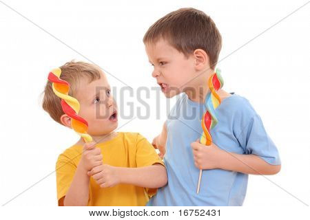two brothers with lollipops - conflict - isolated on white