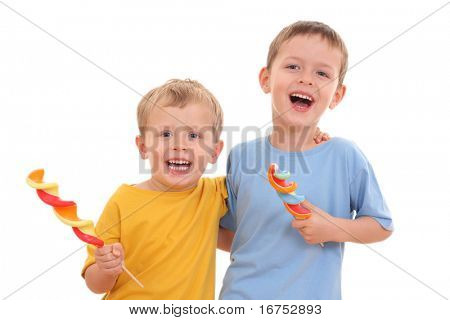 two boys with big lollipops isolated on white