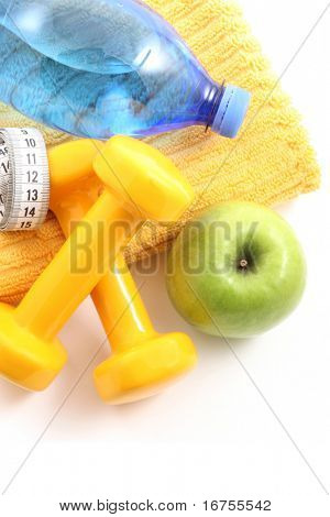 dumbbells towel water and apple - ready to fitness