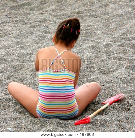 Candy Striped And Crossed Legged Beach Baby