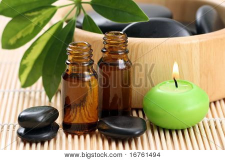 spa and wellness - massage accessories - pebbles and essential oil