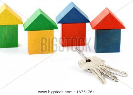 wooden houses and keys isolated on white