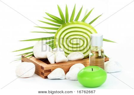 bar of glycerin soap with green leaf isolated on white