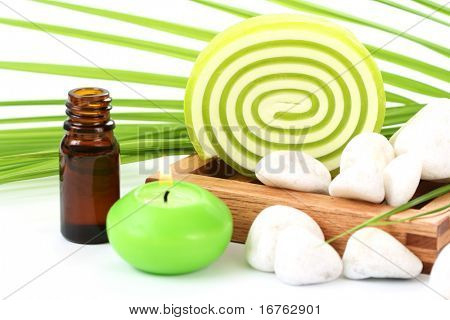 bar of glycerine soap with green leaf isolated on white