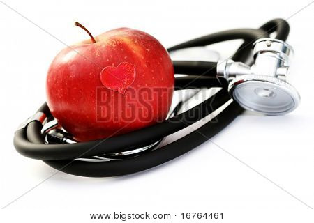 stethoscope and red apple on white - healthy living