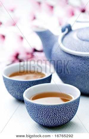 two cups of tea with pink flowers - food and drink