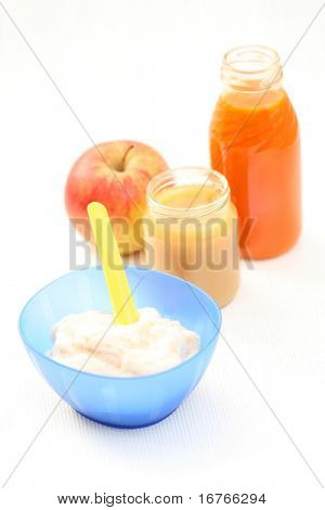 bottle of juice and bowl of porridge - baby food