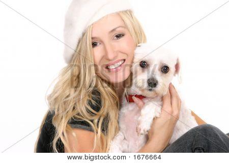 Sitting Girl Cuddling A Dog