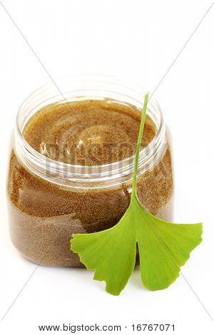 jar of body scrub on white - beauty treatment