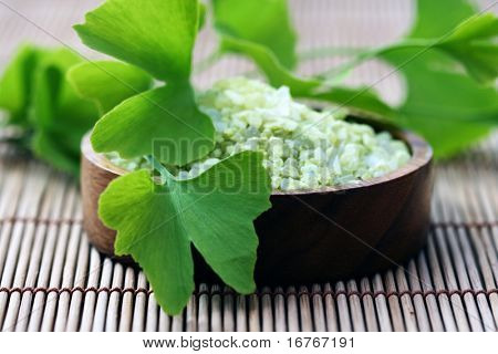 bowl of bath salt with ginko - beauty treatment