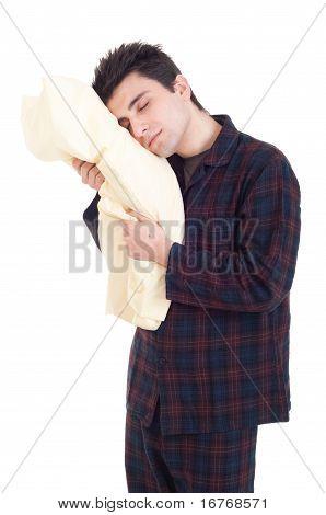 Man In Pajamas Holding Pillow