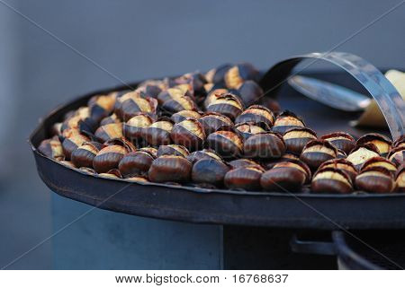 Roasted chestnuts on the iron tray