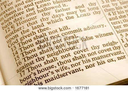 Close Up Of The 10 Commandments In An Old Bible.