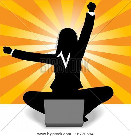 Business woman sits at laptop computer and raises fist and arm to celebrate her success.