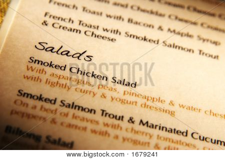 Open Menu Book With Salads As Center Point