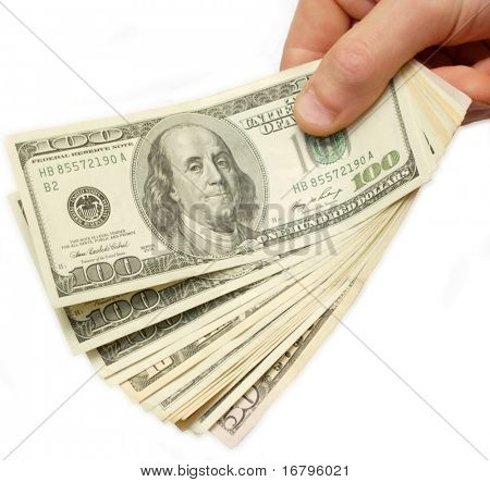 US Dollars in hand, over white, isolated with clipping path