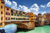 Side View Of Medieval Bridge Ponte Vecchio In Florence, Italy poster