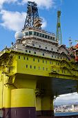 stock photo of oil drilling rig  - oil rig on harbour for make reparations - JPG