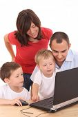 parents and two sons having fun with computer game isolated on white