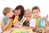 stock photo of card-making  - mother and children making Christmas cards  - JPG