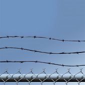 Vector illustration of the top of a a chainlink fence topped by three strands of barbed wire, agains