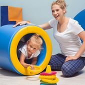 Child Exercising During Occupational Therapy poster