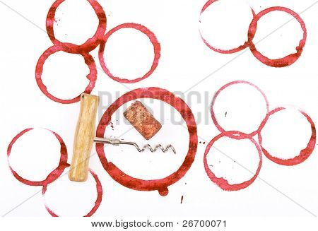 Wine cork, corkscrew and round, red wine stain on white table cloth