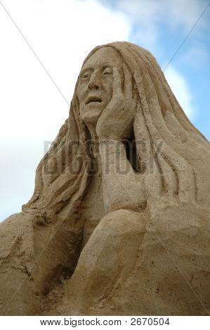 Triste mujer de arena