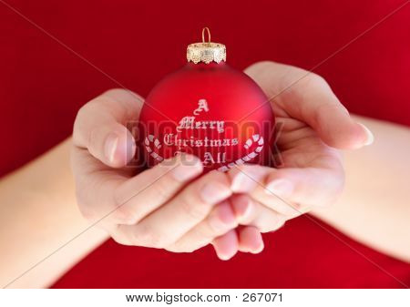 Woman Holding Christmas Ball