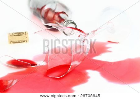 Broken wine glass and spilled red wine