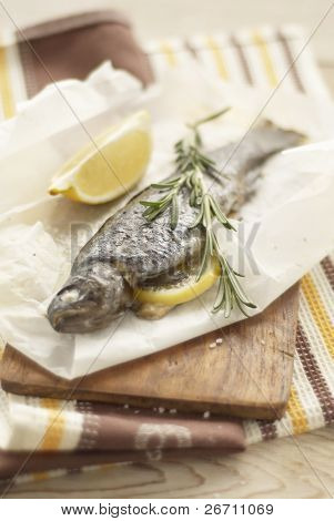 Baked trout in parchment stuffed with lemon and rosemary