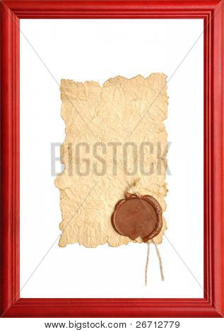 old paper with a wax seal in wooden frame