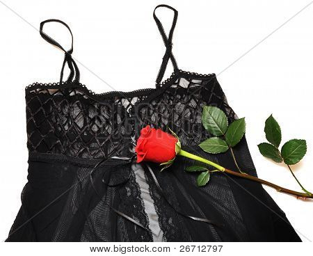 black lace corset and red rose on white